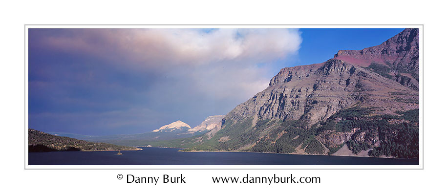 Picture: Smoke from a forest fire sweeps across St Mary's Lake, Glacier National Park, Montana